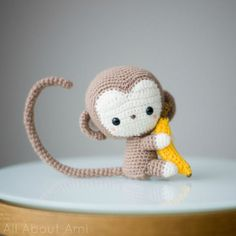 "Meet Kiko, our kawaii baby monkey that we designed as a part of our Chinese New Year series!  He is adorably sweet with his poseable tail, arms and legs, and he is clutching on tightly to his favourite snack of all: a banana! Materials:lightweight tan yarn, level 3  (I used ""Patons Astra"" in ""Medium tan"")lightweight beige yarn, level 3  (I used ""Patons Astra"" in ""Aran"")sport weight yellow yarn, level 2 (I used Lion Brand Bonbons in the colour combo ""Beach"")2 mm Clover Amour crochet hookYarn…"