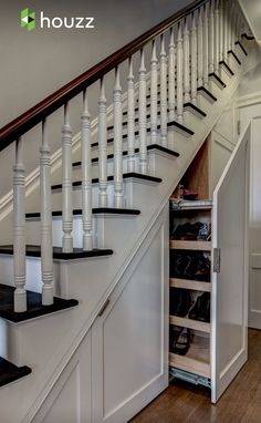 Under the stairs hidden storage pullout.