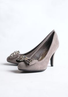 """Posh And Pretty Bow Pumps 34.99 at shopruche.com. Add a touch of charm to your outfits with these faux suede heels in taupe. Perfected with gold and pewter details.  All man-made materials, 3.5"""" heel , Slightly padded footbed"""