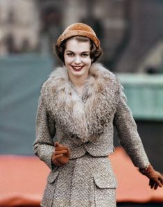 Jan Rylander wearing wool tweed suit and rayon blouse by Jeanne Campbell for Sportwhirl, Emmé beanie, and Aris gloves, 1957