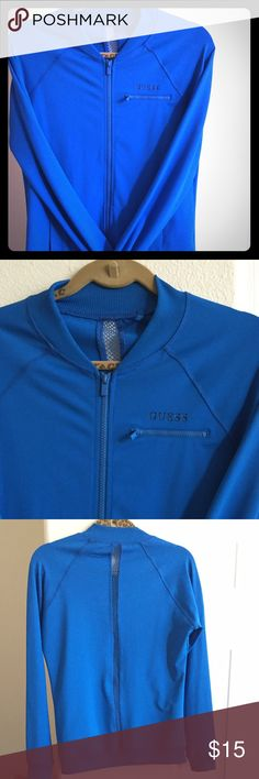 NWOT GUESS athletic jacket Blue guess athletic jacket...88% polyester 12 % spandex that is comfy to use while working out! Never worn but no longer has tags--PERFECT condition. Guess Jackets & Coats