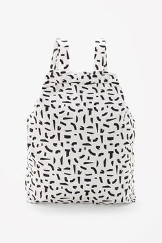 Made from lightweight technical fabric, this cotton-lined backpack has a metal zip fastening and wide drawstring around the top. Multi-functional, it can also be worn as a tote using the two fabric handles.