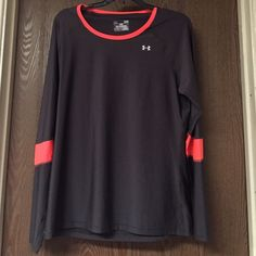 UA shirt Nice neon orange under armour long sleeve workout shirt. It really does keep your body cool during workouts. Under Armour Tops Tees - Long Sleeve