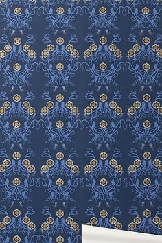 more animals hiding out in traditional patterns. and all the better, they're OCTOPUSES this time. Anthropologie wallpaper.