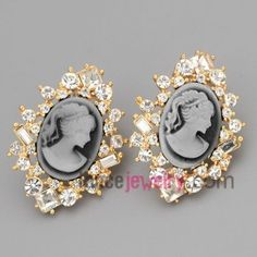 Specia lretro feel stud earrings with gold brass decorated shiny rhinestone and cubic zirconia with beautiful woman