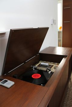 Console stereos.  We had one of these in our living room.  Both ends had room inside for storing the big, round records.