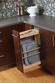 Tray storage in a pull-out offers a practical and convenient use of space - Dura Supreme Cabinetry