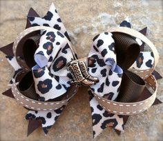 Brown leapered bow with cowboy boots