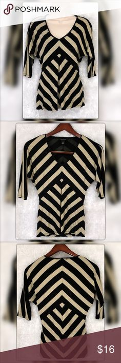 "White House Black Market Chevron Shimmer Top White House Black Market Chevron Shimmer Top. Chic Black and gold Shimmer with slight doorman sleeves. Rayon Polyester Spandex Blend mesh lining. Pit to pit measures 16"" Length 26"". Gently used with no flaws. Open to offers ❤️ White House Black Market Tops Blouses"