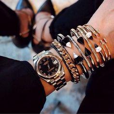 Hermes, Cartier, David Yurman & Tory Burch...now that is a fabulous stack!