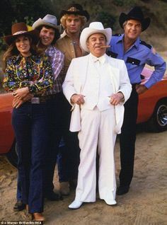 The Dukes Of Hazzard aired on CBS from 1979 until 1985 and starred Tom Wopat (left holding Catherine Bach) and John Schneider (middle) as cousins