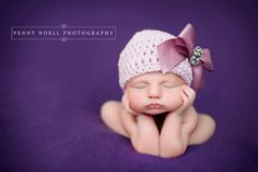 don't love big bows on babies, but this hat is darn precious.