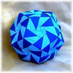 Modular Origami is a unique paper folding craft where you combine at least two pieces of paper to form a geometric shape. These geometric units are then combined to create some of the most unique and colorful models. These modular shapes come in all. Paper Folding Crafts, Origami Paper Folding, Modular Origami, Paper Crafts, Math Crafts, Crafts To Do, Arts And Crafts, Maths Display, Origami Diagrams