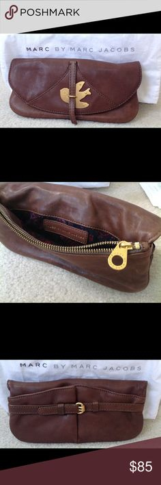 Brown leather Marc Jacobs clutch Excellent condition Marc Jacobs clutch. Comes with factory storage bag. Marc by Marc Jacobs Bags Clutches & Wristlets