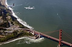 """A new Virgin America A320 jet, aptly named """"My Other Ride Is a Spaceship,"""" flies in tandem with the SpaceShipTwo rocket plane and its mothership over the Golden Gate Bridge on April 6. The aircraft landed at San Francisco International Airport, becoming the first planes to arrive at the new $388 million, 640,000-square-foot Terminal 2. SpaceShipTwo is expected to begin rocket-powered suborbital test flights during 2012 - not from San Francisco, but from the Mojave Air and Space Port near Los…"""