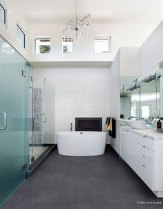 Bathtub in front of fireplace, big walk in shower,  Love the spacious vanity.