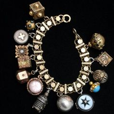 Charm Bracelet made from watch chain and fobs