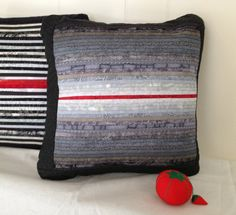 Quilted pillow in shades of grey with one red line. by AnnBrauer #quilts #artquilts #quilted pillows