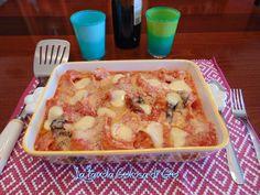 Conchiglie di pasta ripiene al forno con ricotta