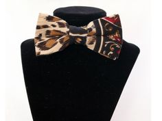 Five. Tan and black leopard print pre-tied bow tie with adjustable strap.