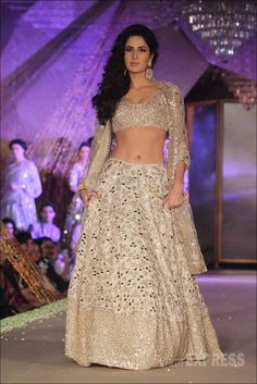"Exquisite Indian Fashion by Manish Malhotra, ""Regal Threads Fashion Show By MUMBAI, Katrina Kaif walks the runway at Regal Threads Fashion Show By Manish Malhotra at Trident Hotel in Mumbai, India. (Photo by Chirag Wakaskar/Getty Images)"" Lehenga via Indian Lehenga, Red Lehenga, Bridal Lehenga, Lehenga Choli, Sarees, Saree Gown, Manish Malhotra Designs, Manish Malhotra Collection, Chic"