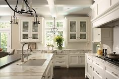 702 Hollywood: Kitchens to Love  Marble counter tops. Calacutta Gold?