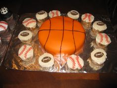 Sports themed birthday cake and cupcakes by Charlene Owens
