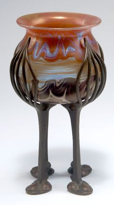 Loetz, Klostermühle. 'Phänomen' vase with bronze mounting, 1900. H. 18.4 cm. Designed by Franz Hofstötter. Cased glass, milk opal and clear. Lower part black with silver-yellow threads, middle with silver-yellow threads and the upper part red with silver-yellow threads. Combed pattern, Phänomen Gre 358, matt mother of pearl lustre. Signed: Loetz Austria (engraved) hidden behind the bronze mounting.