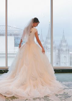 modest wedding dress with long train from alta moda.  ---          ---  photo: rebekah westover