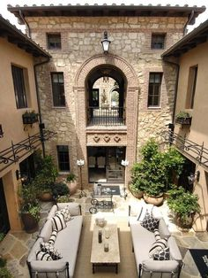 Courtyard, Italian villa style home. Reminds me of our Turks & Caicos trip. Would love a courtyard in backyard, with a one story covered porch (square shaped) on the left and a room on the right, with a water feature in center.