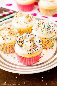 Super-moist Vanilla Cupcakes topped with my favorite vanilla buttercream frosting and sprinkles. Recipe by deliciouslysprinkled.com