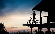 Alex silhouetted with his bike in Bali...What it's all about. #bali #biking