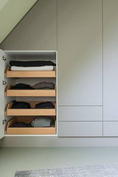 pull out tray storage inside no handle cupboard door. plain.