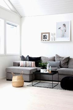 Grey sofa, sleek black table and basket. Floating shelf with black and white art. Living Room Inspiration, Interior Inspiration, Home Living Room, Living Spaces, My Ideal Home, Minimalist Home, Room Set, Decor Interior Design, House Design