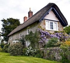 Fairytale cottage with climbing wisteria and thatched roof Fairytale Cottage, Storybook Cottage, Little Cottages, Cabins And Cottages, Stone Cottages, Stone Houses, Cute Cottage, Cottage Style, Petits Cottages