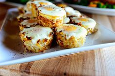 Eggs in Hash Brown Nests. These are the perfect little side dish for Easter Brunch: Tender-but-crispy potato nests with a luscious baked egg in the middle. They go perfectly with ham for a more substantial brunch, or they& Fast Food Breakfast, What's For Breakfast, Breakfast Dishes, Breakfast Recipes, Breakfast Cooking, Breakfast Casserole, Breakfast Potatoes, Vegetarian Breakfast, Breakfast Cupcakes