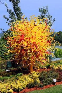 """""""The Sun"""" is one of Chihuly's boldest pieces at the Arboretum in Dallas. Spires of blown glass jut high in the sky.  Photo by Elliott Muñoz"""
