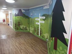Rainbows Children's Hospice Corridor - on the other-side of the doors, children and their families are greeted by a fresh and friendly Alpine scene providing way-finding to matron's office, dining room and family flats.