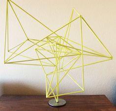 Add lime green modern geometric wire sculpture by artist Corey Ellis