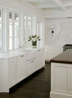 white cabinets + dark wood floors.