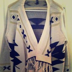 Hi-Lo Fringe Cardigan From the glamorous Élan boutique out of Miami comes this fringe cardigan with beautiful Aztec print. Although label says OS, I believe it more accurate to say S, M or L Elan Sweaters Cardigans