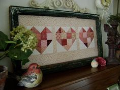 Perfect for the leftover blocks I have sitting around....  3 hearts quilted blocks
