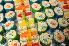 Candy Sushi - made with Rice Krispie treats, Fruit Roll Ups, gummy worms and swedish fish. I found the best instructions at http://www.mommyknows.com/birthday-party-candy-sushi/