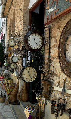 Vintage clocks on the streets of Guadalest, Spain
