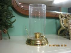 "PartyLite Candle Holder in GertrudB66's Garage Sale in Clear Lake , TX for $25.00. Brass and Glass candle holder.  Can hold either small pillars or 6"" tapers."