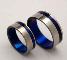 """Our titanium ring designs have taken off in the Netherlands! This Dutch wedding blog features our """"To the Winds Resign' Titanium Wedding Band Set."""