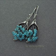I bought these beads 3 years ago, they are (I'm almost positive!) turquoise matte glass drop beads by Miyuki...these lovely earrings give me inspiration to use them.