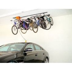 Check out overhead garage storage racks, systems and other solutions including garage bike hoists, storage hooks and garage lifts at Organize-It. Bike Storage Systems, Garage Storage Racks, Metal Storage Cabinets, Overhead Garage Storage, Garage Shelving, Toy Storage, Garage Organization, Organizing Ideas, Sports Storage