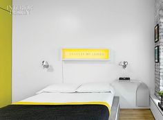 City of Dreams: Koray Duman's Modern New York Walk-Up | In the bedroom, a light box by Matilde Alessandra hangs over a platform bed made by stacking ½-inch-thick layers of wool felt. The custom nightstand is by Carol Egan Interiors. #design #interiordesign #interiordesignmagazine #architecture #bedroom #art