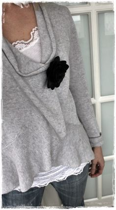 Soft grey sweater with flower pin.